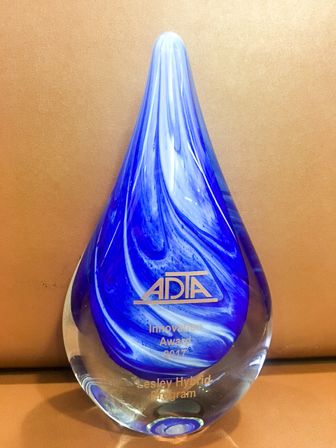 "The ADTA award: a glass teardrop-shaped trophy printed with ""Lesley Hybrid Program."""