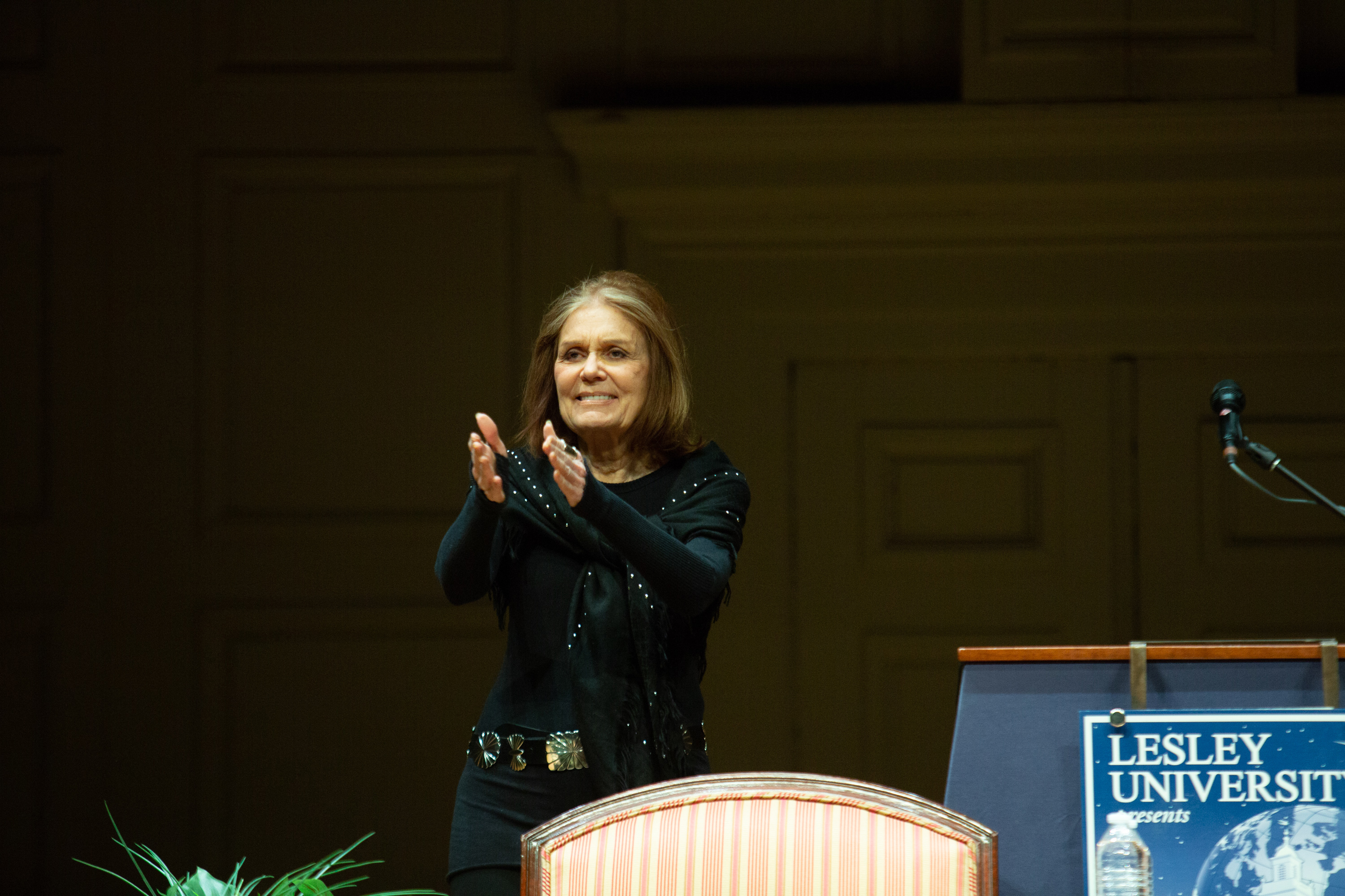 Gloria Steinem applauds on the Symphony Hall stage
