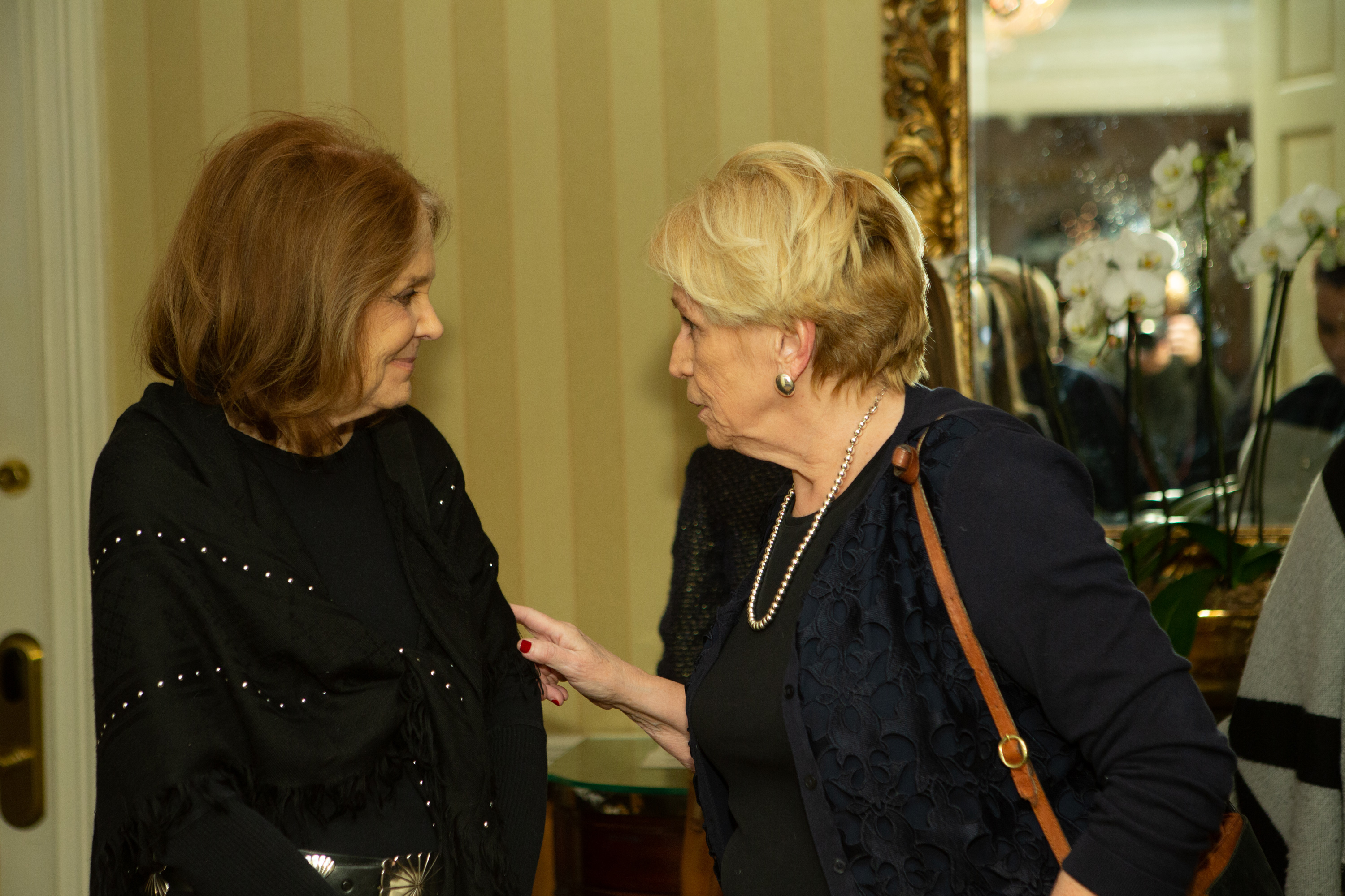 Gloria Steinem listens as Margaret McKenna talks to her