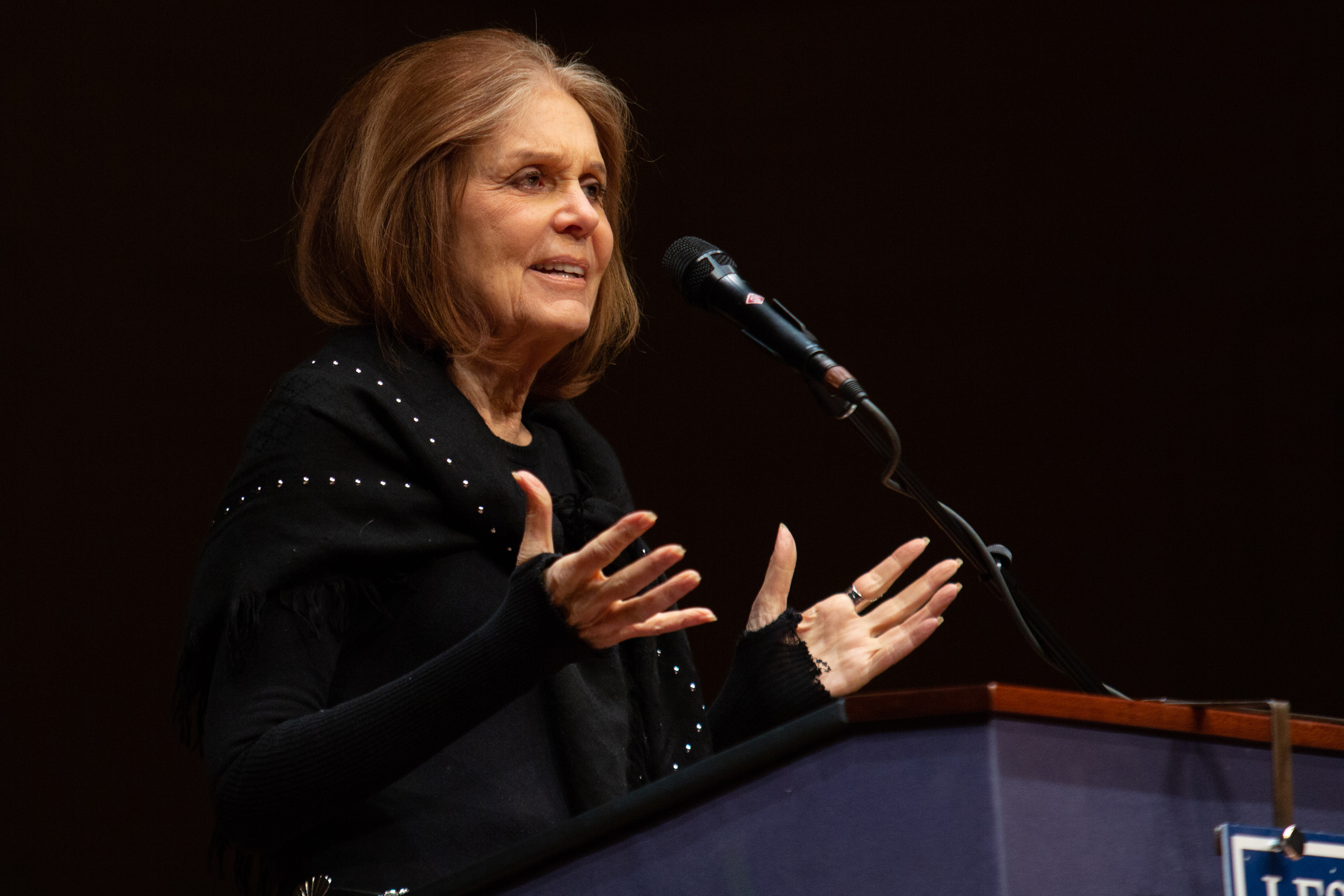 Gloria Steinem speaks at the Symphony Hall podium