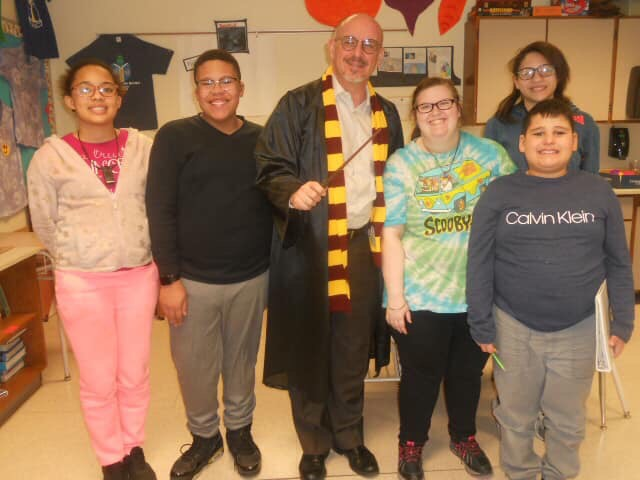 Bert Carter dressed as Harry Potter with students.