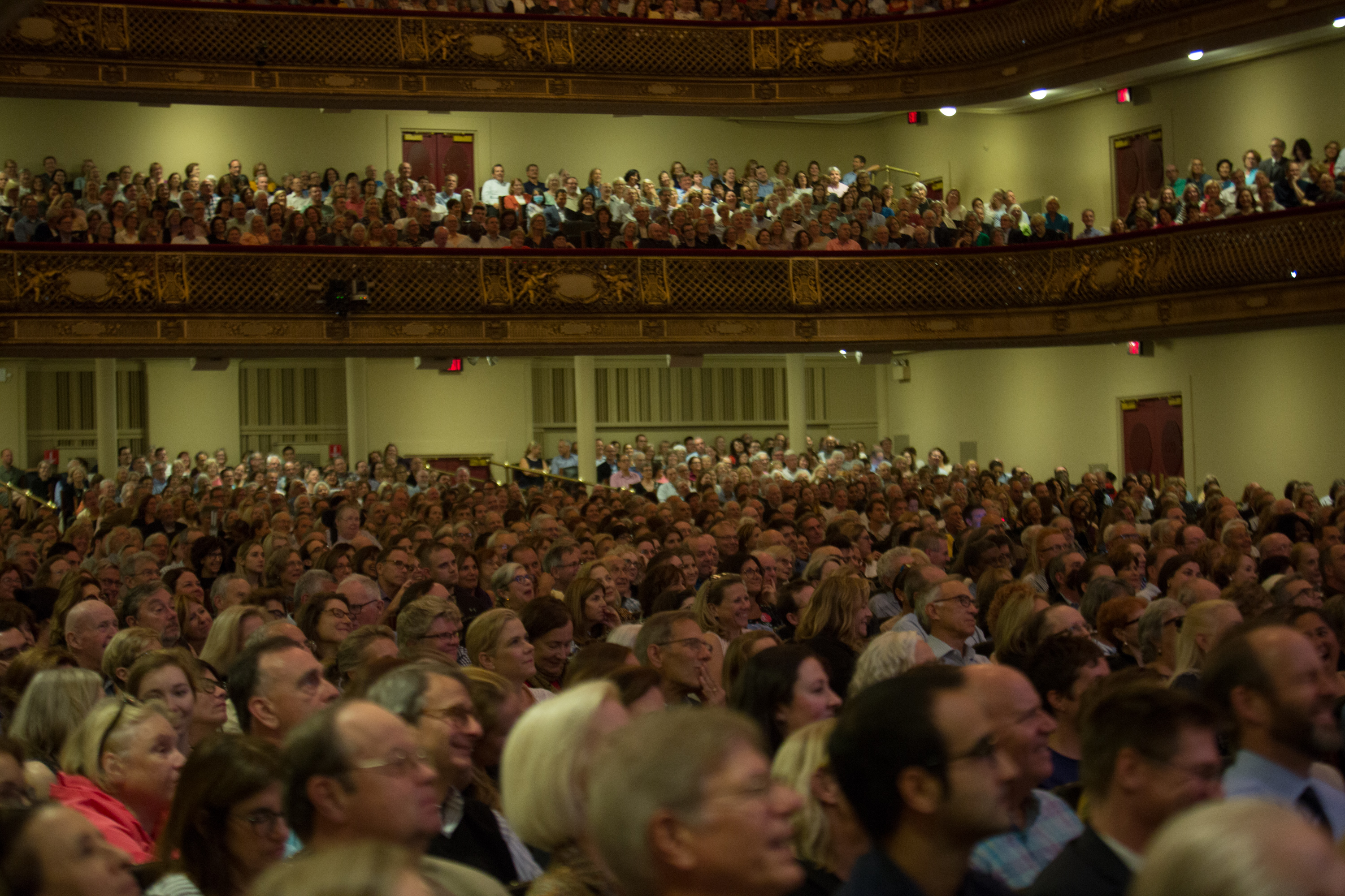 view of the audience in Symphony Hall listening to James Comey
