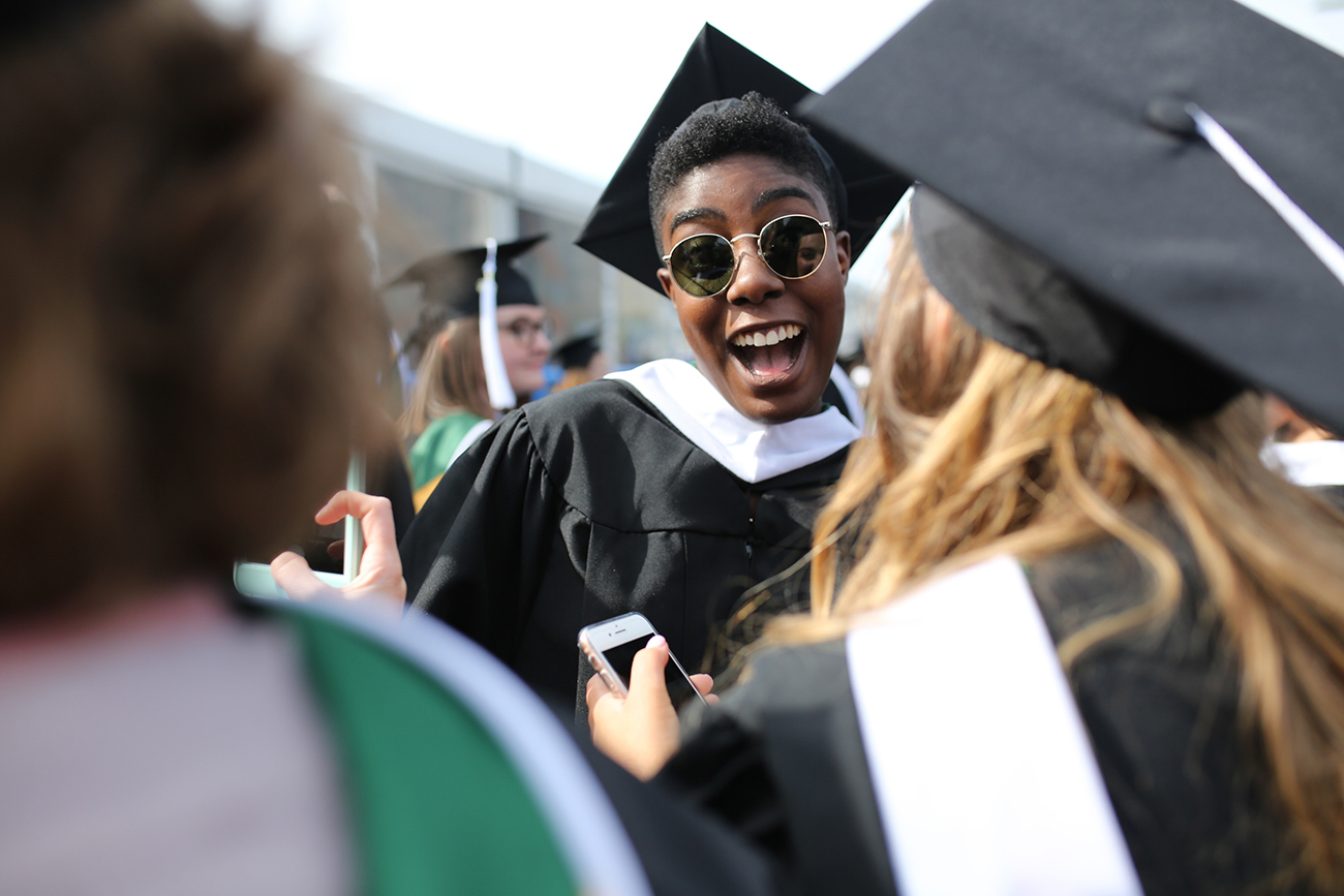 A female student smiles excitedly before the ceremony.
