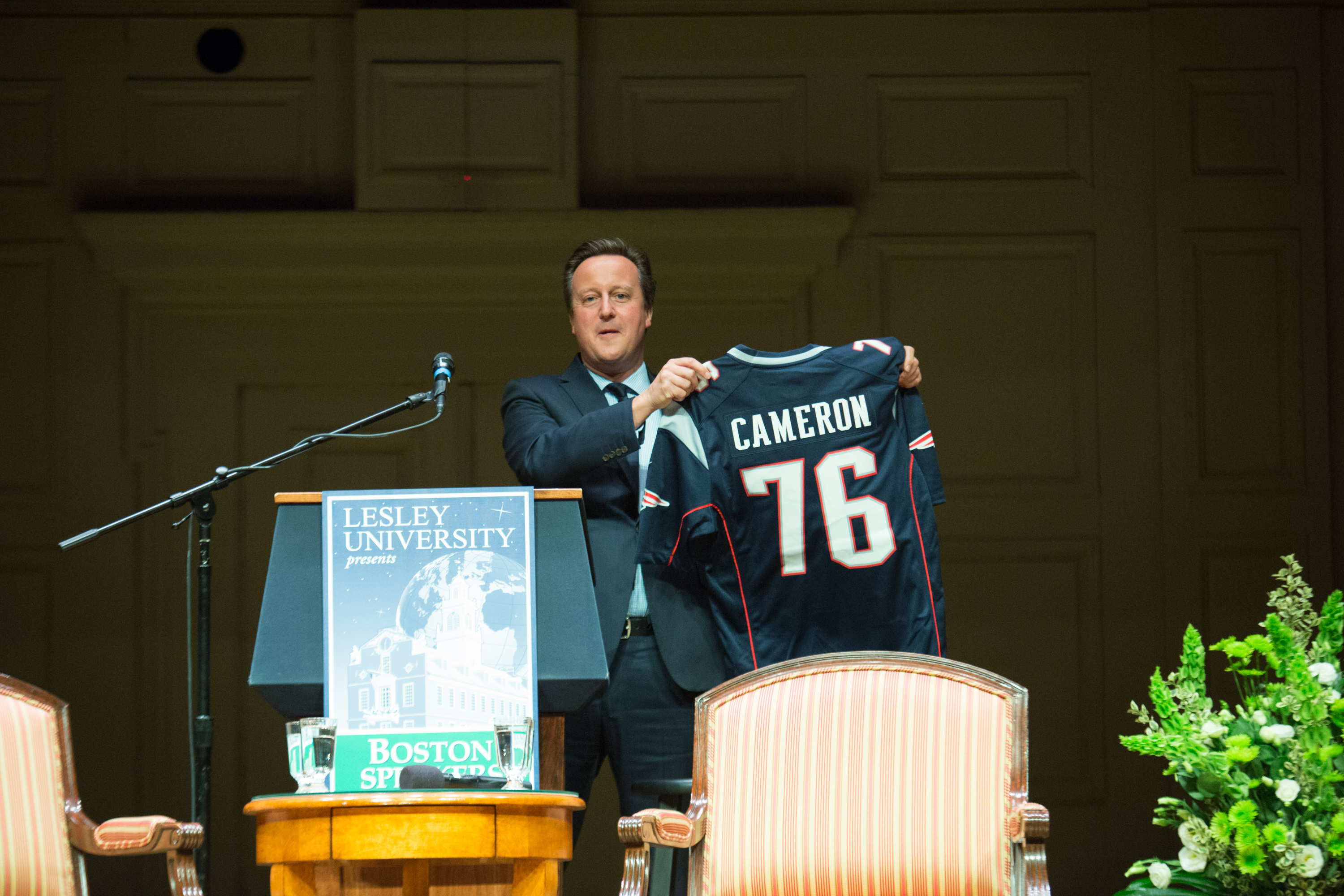 David Cameron holding up Patriots Football Jersey
