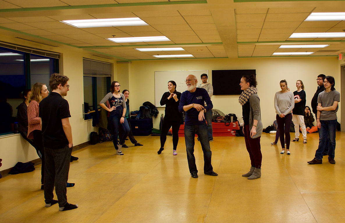 Students pause for a laugh during swing dance class in dance studio.