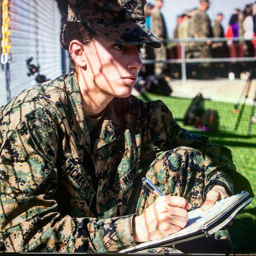 Sgt. Elize McKeley sketching in her camo uniform
