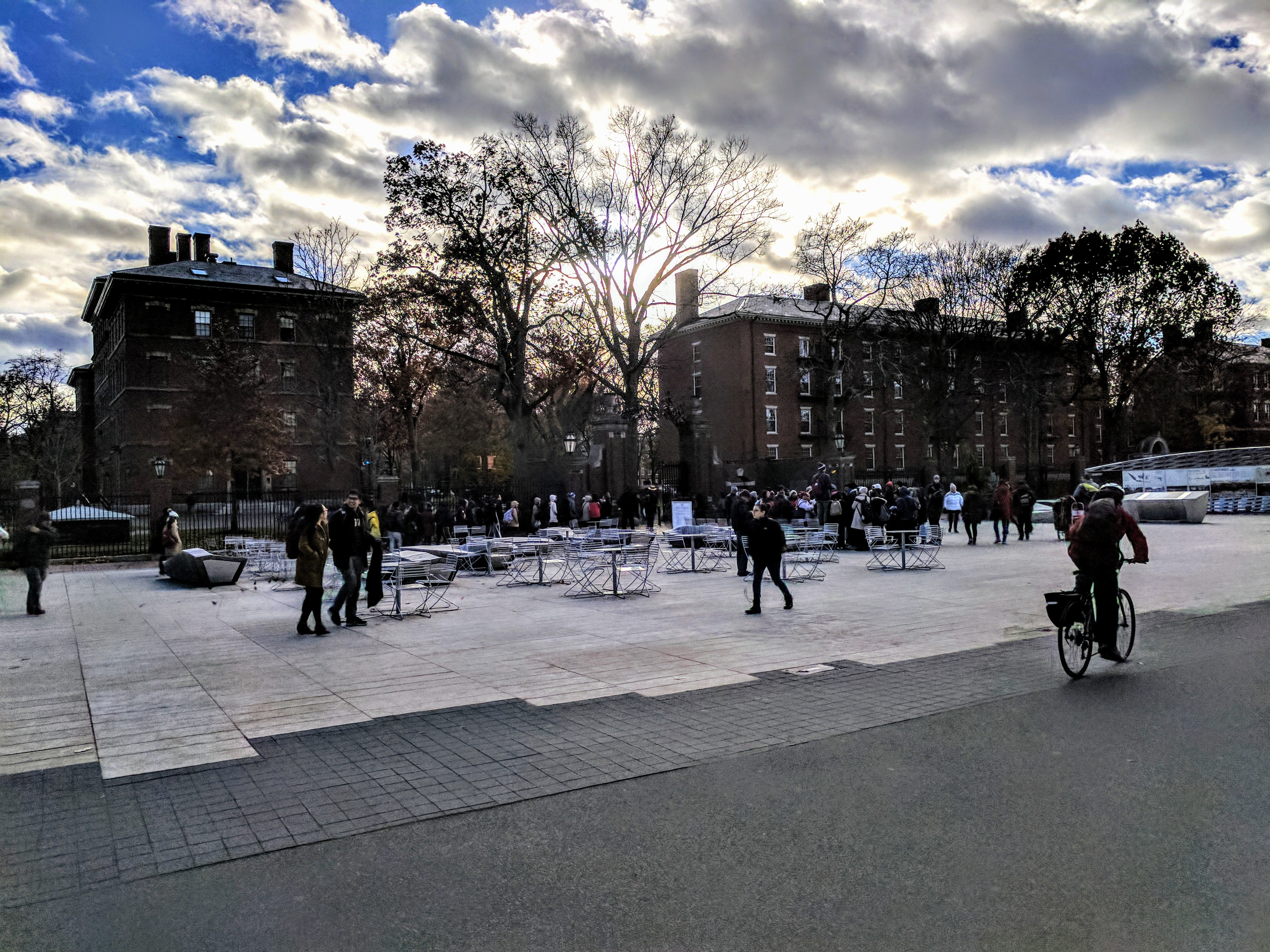 Outdoor photograph of Harvard Yard in the winter with blue sky and clouds.