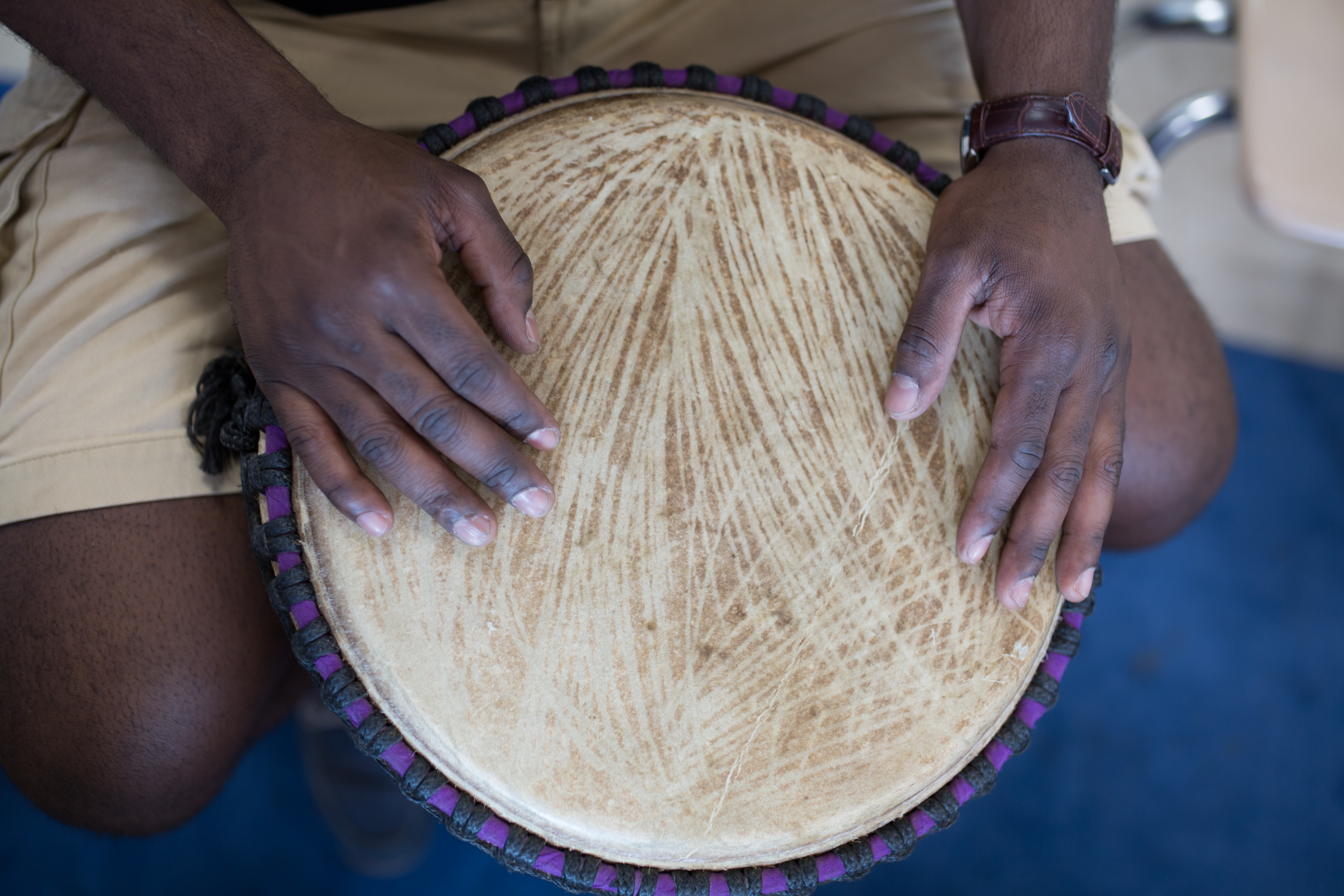 Jonathan Mande's hands on one of his traditional African drums.