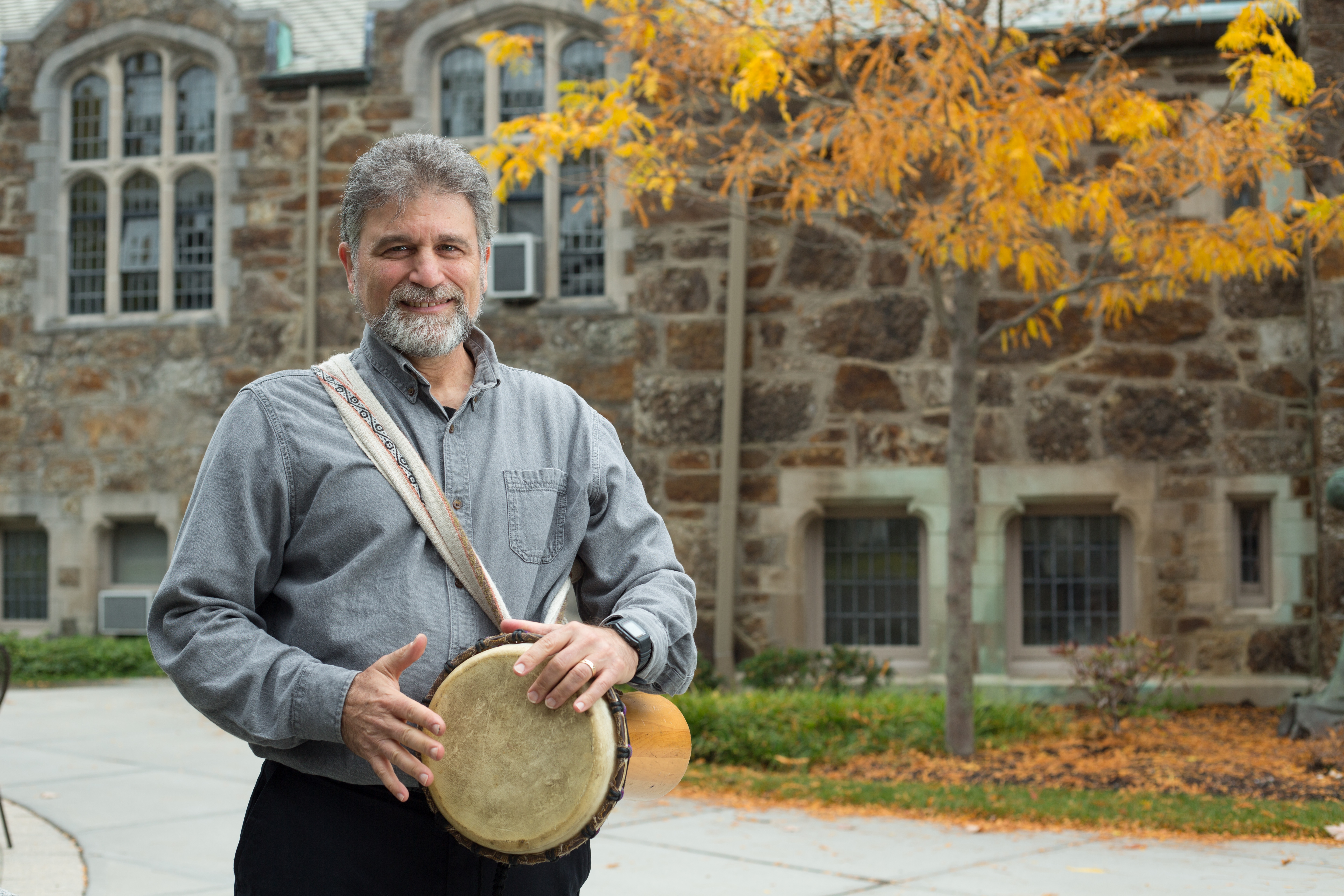Kossak holds a drum on campus.
