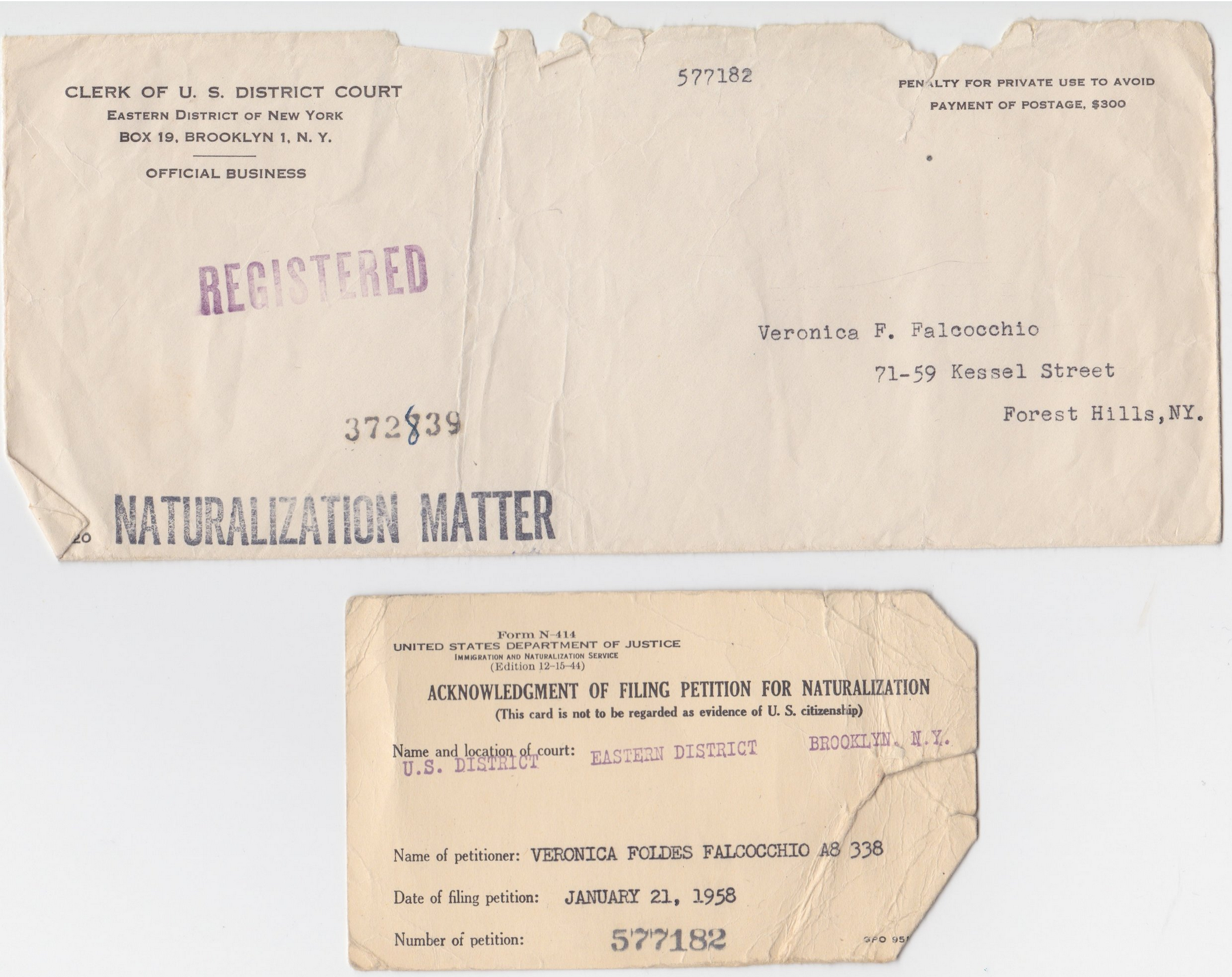 Old envelope and card documenting Maya Erdelyi's grandmother's naturalization