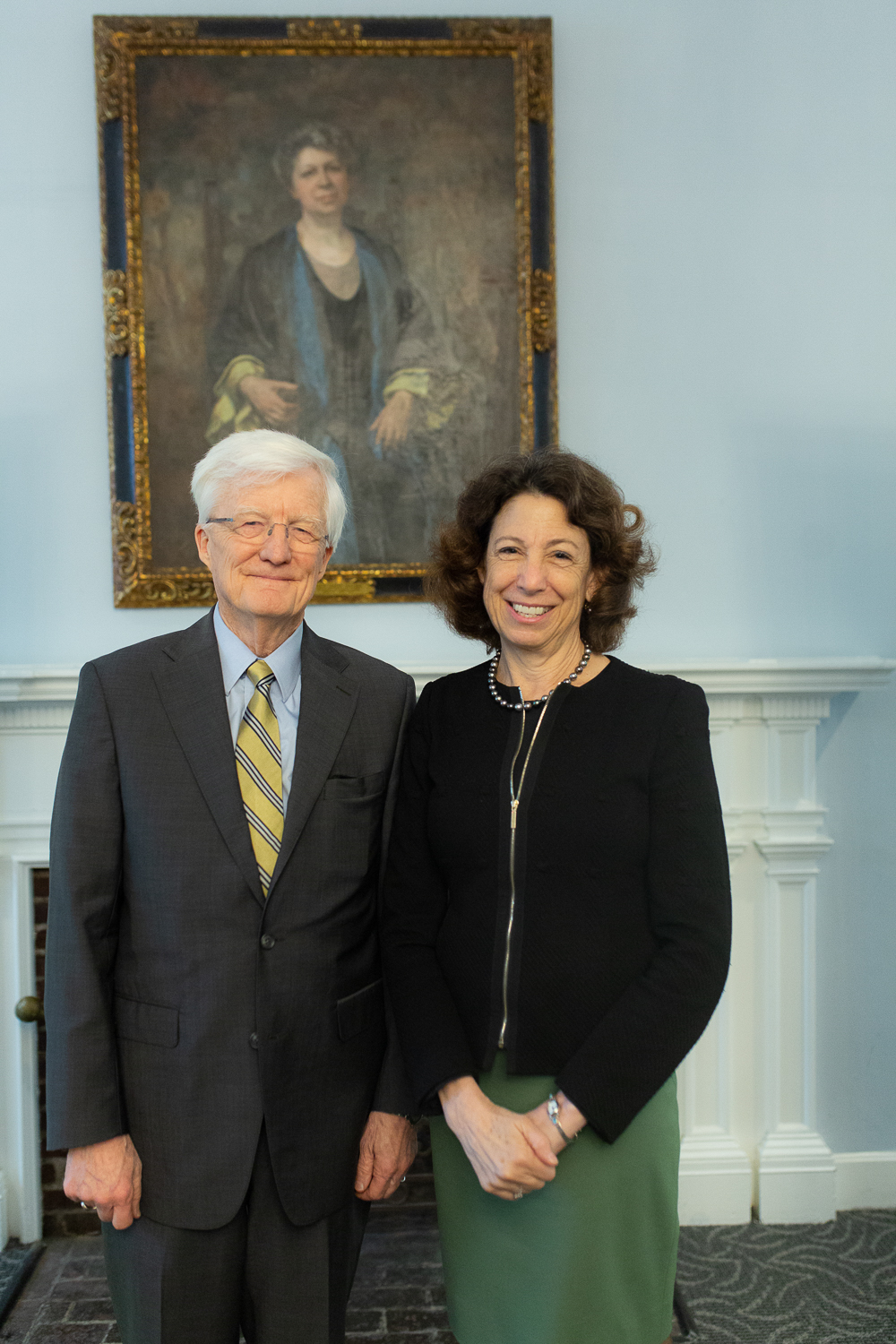 Left to right: Interim President Rich Hansen and President-elect Janet Steinmayer in front of a painting of Edith Lesley.