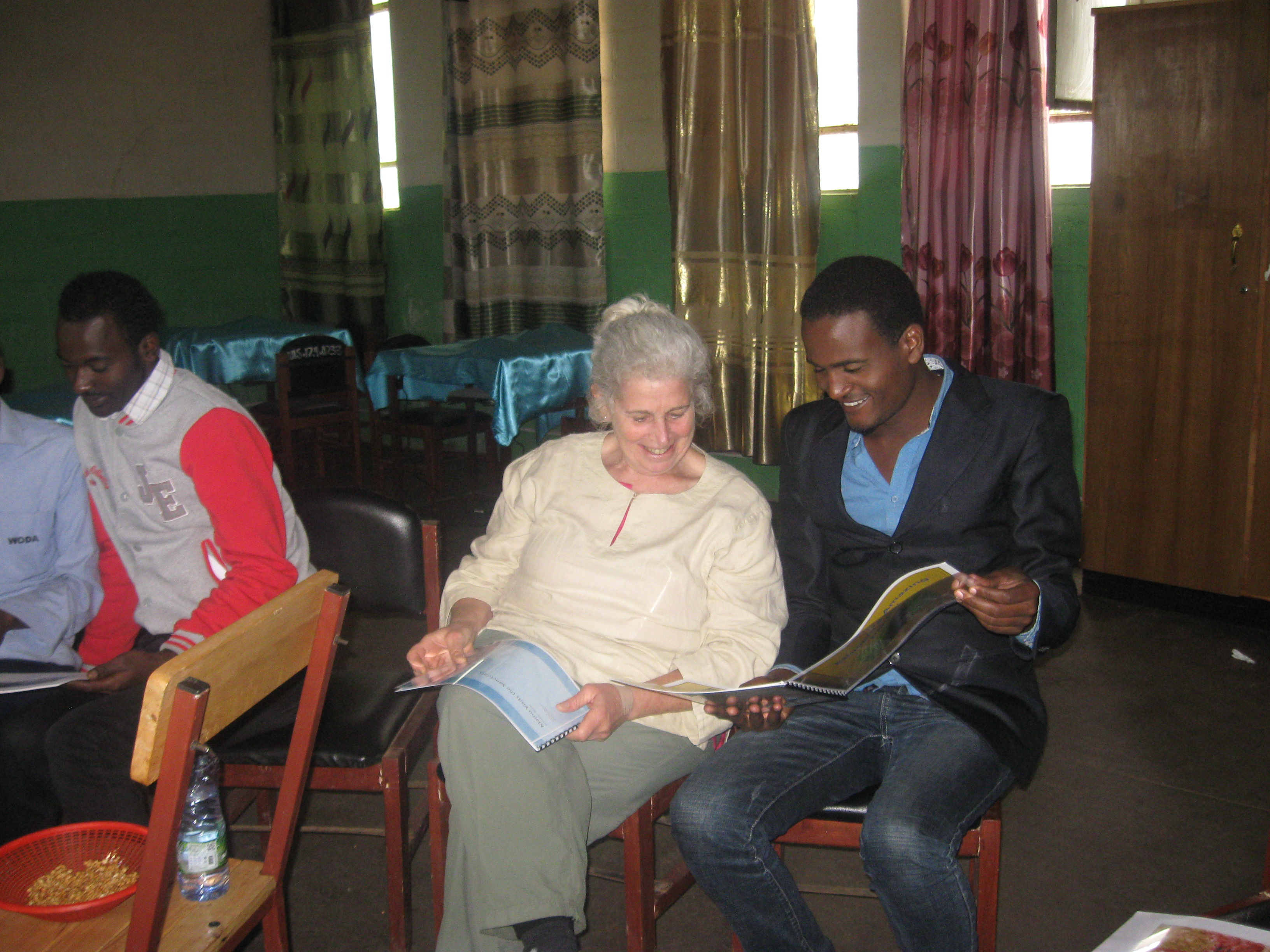 Professor Susan Rauchwerk in Ethiopia showing her children's book to locals.