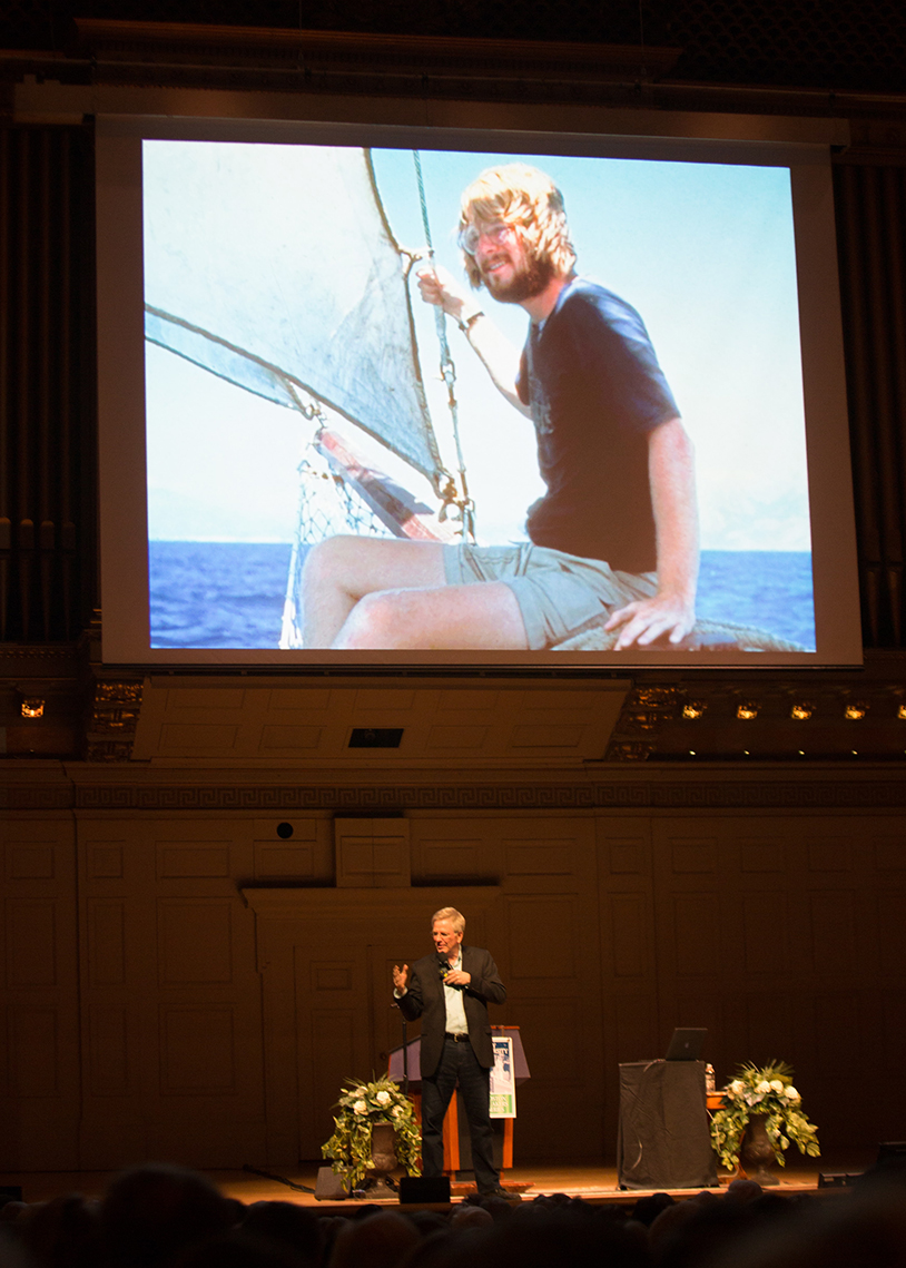 Rick Steves narrates a slideshow at Boston Symphony Hall