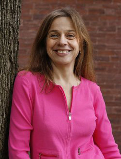 Susan Goodman portrait leaning against a tree.