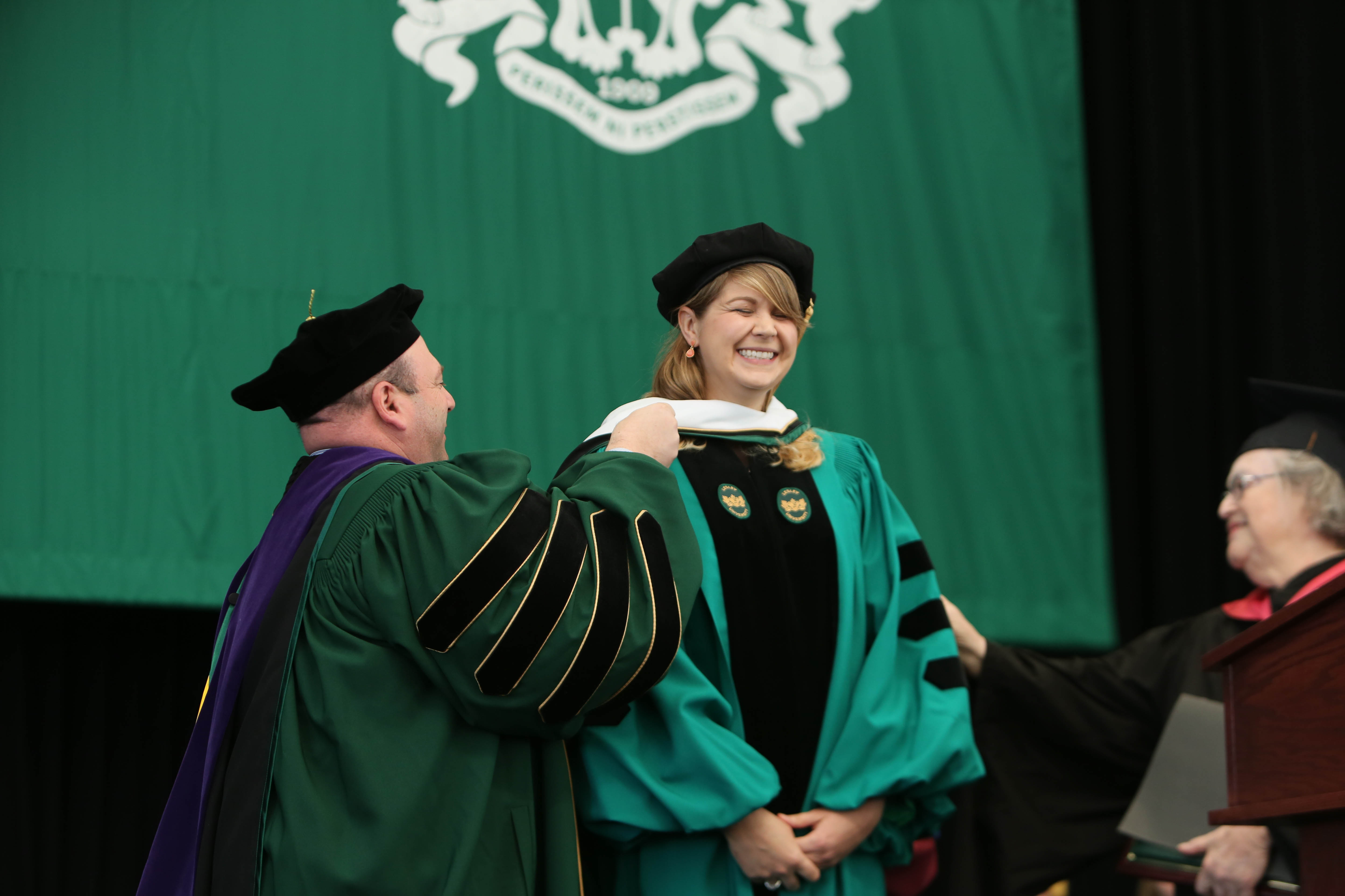 National Teacher of the Year Sydney Chaffee receives her honorary degree at commencement.