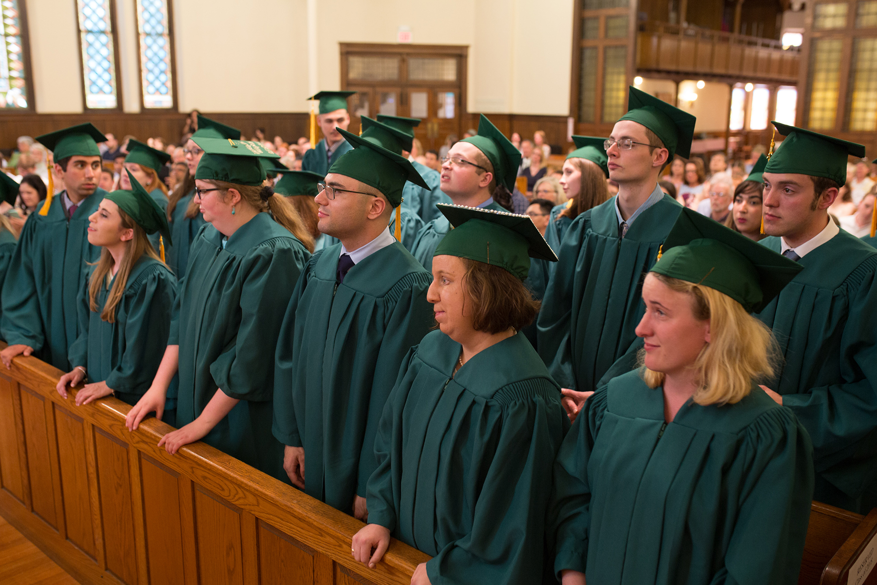 The Class of 2018 is pictured standing and listening during the graduation ceremony.