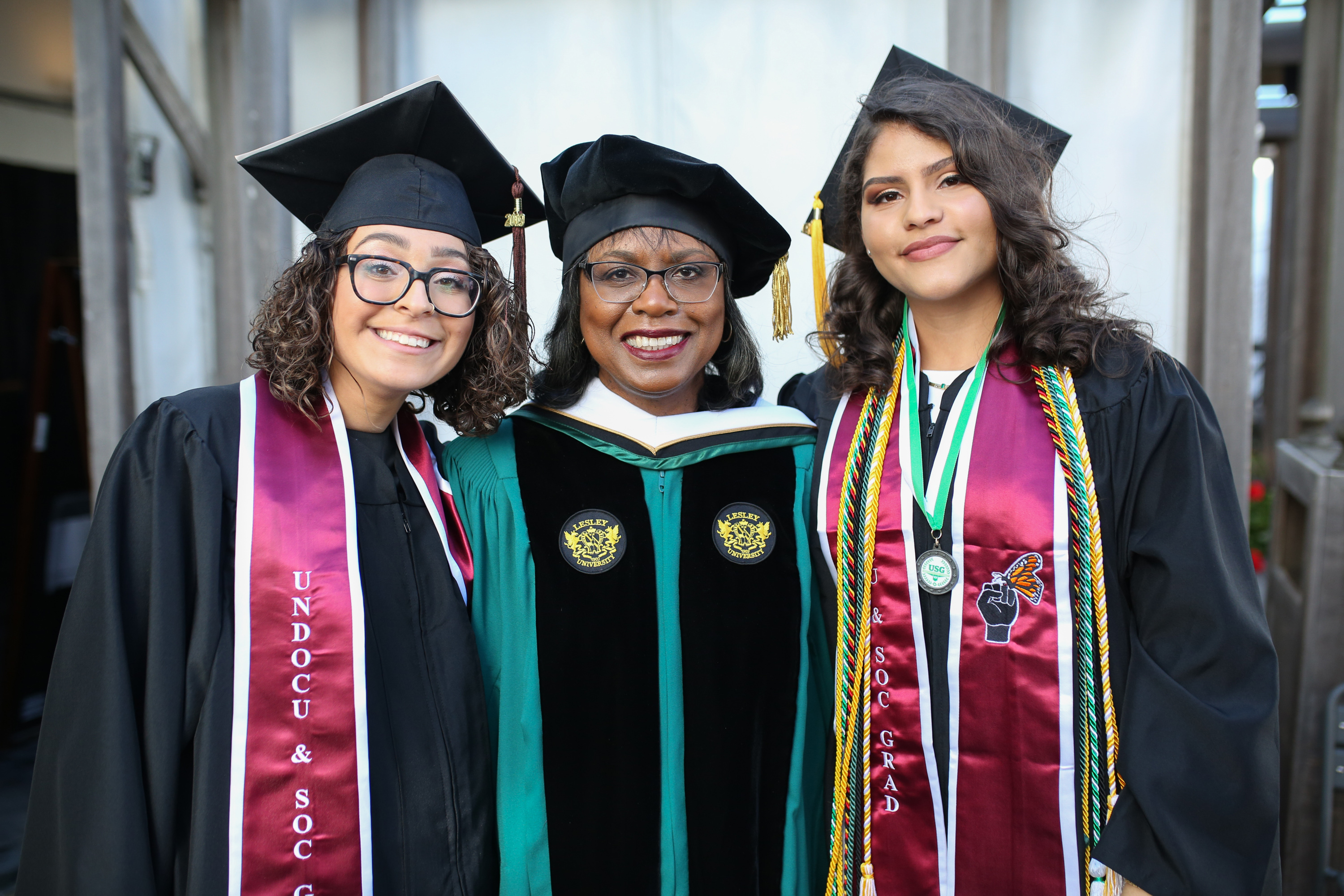 Anita Hill poses with students at Commencement