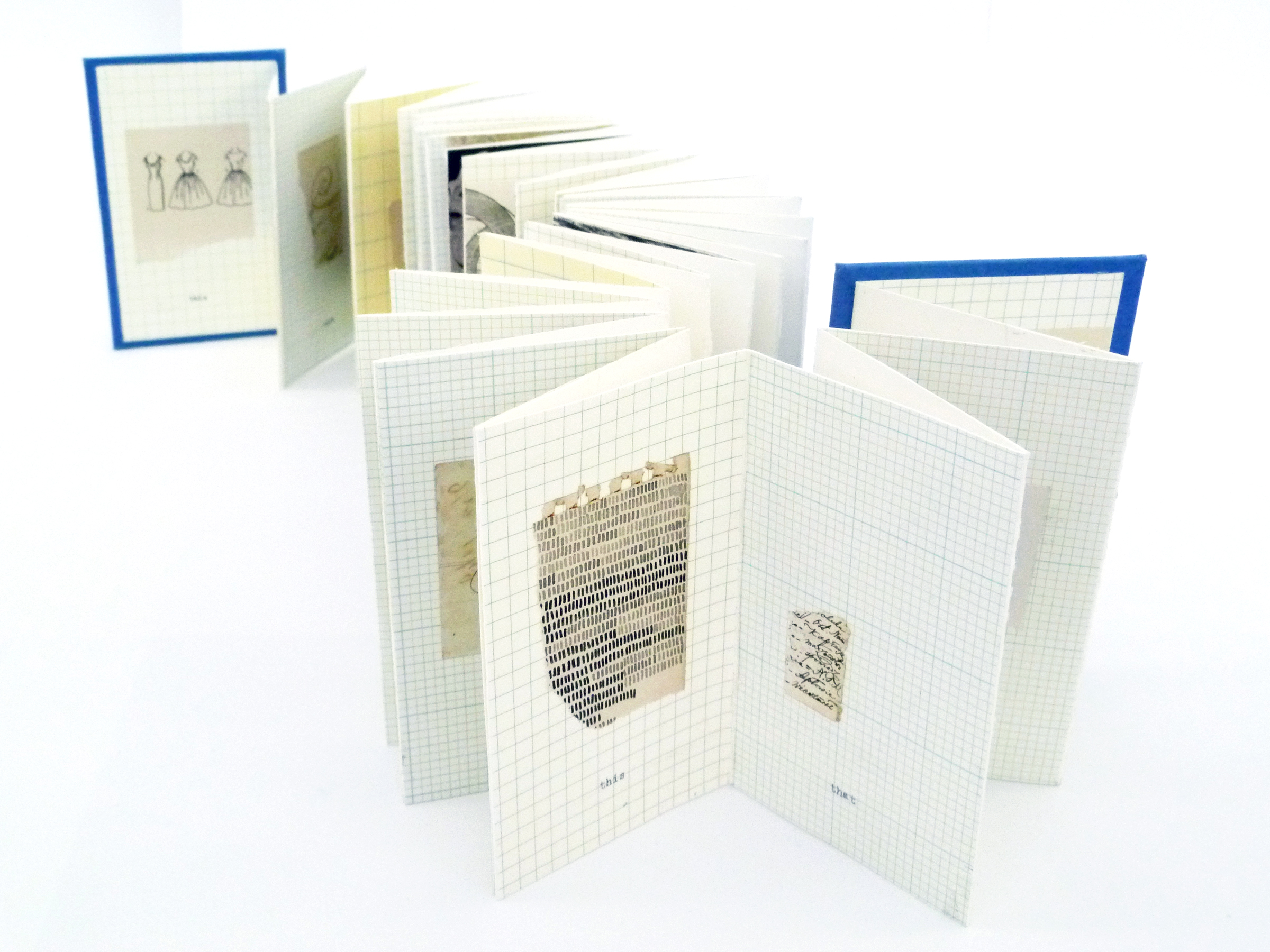 accordian fold artist book made with white graph paper