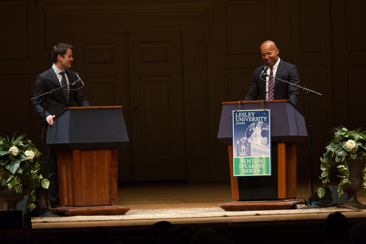 Jared Bowen and Bryan Stevenson on stage together, both behind podiums