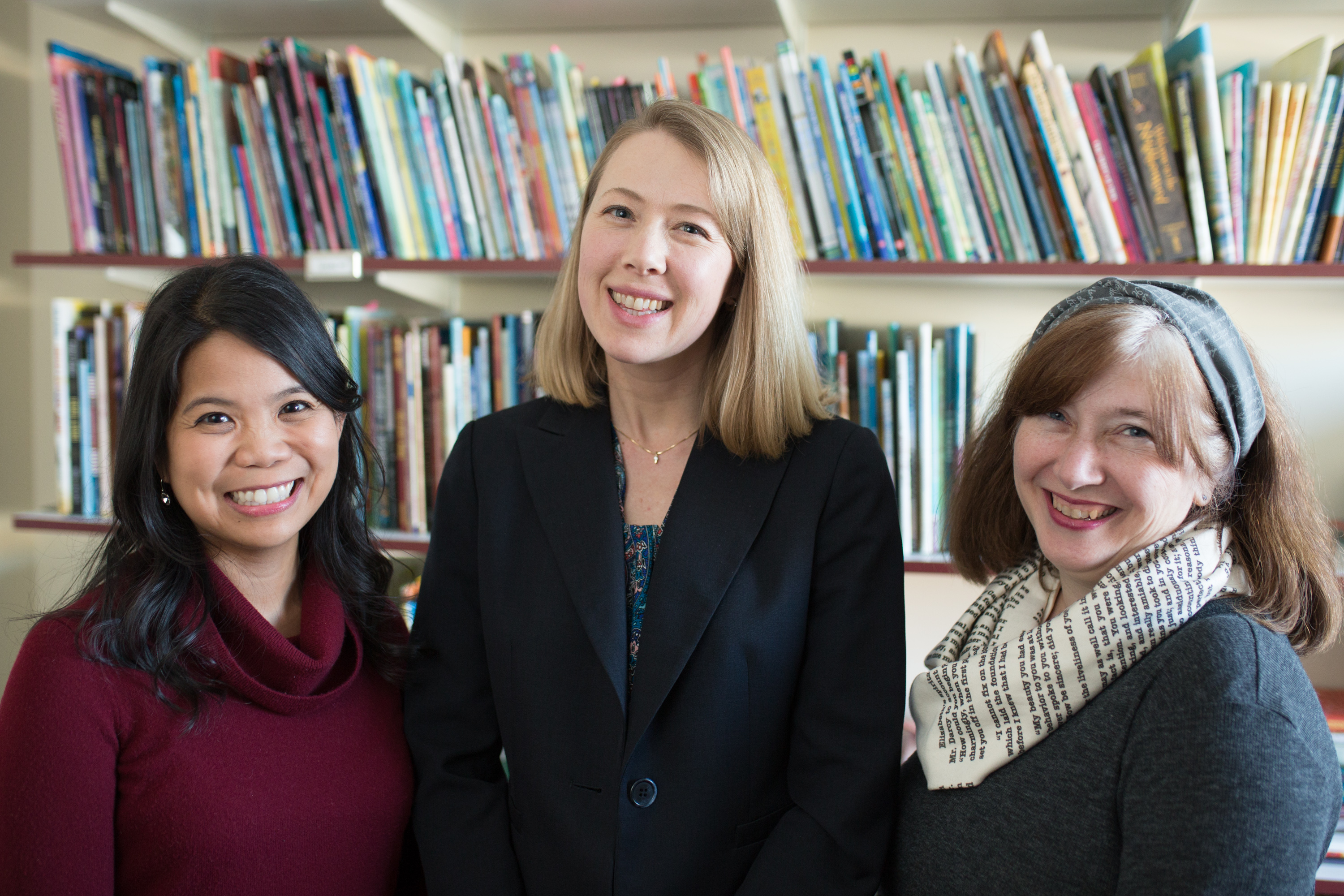 Classroom Bookshelf authors Grace Enriquez, Erika Thulin Dawes, and Mary Ann Cappiello, in front of bookshelf