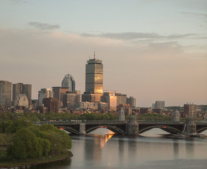 Photograph of downtown Boston and the Charles River at sunset
