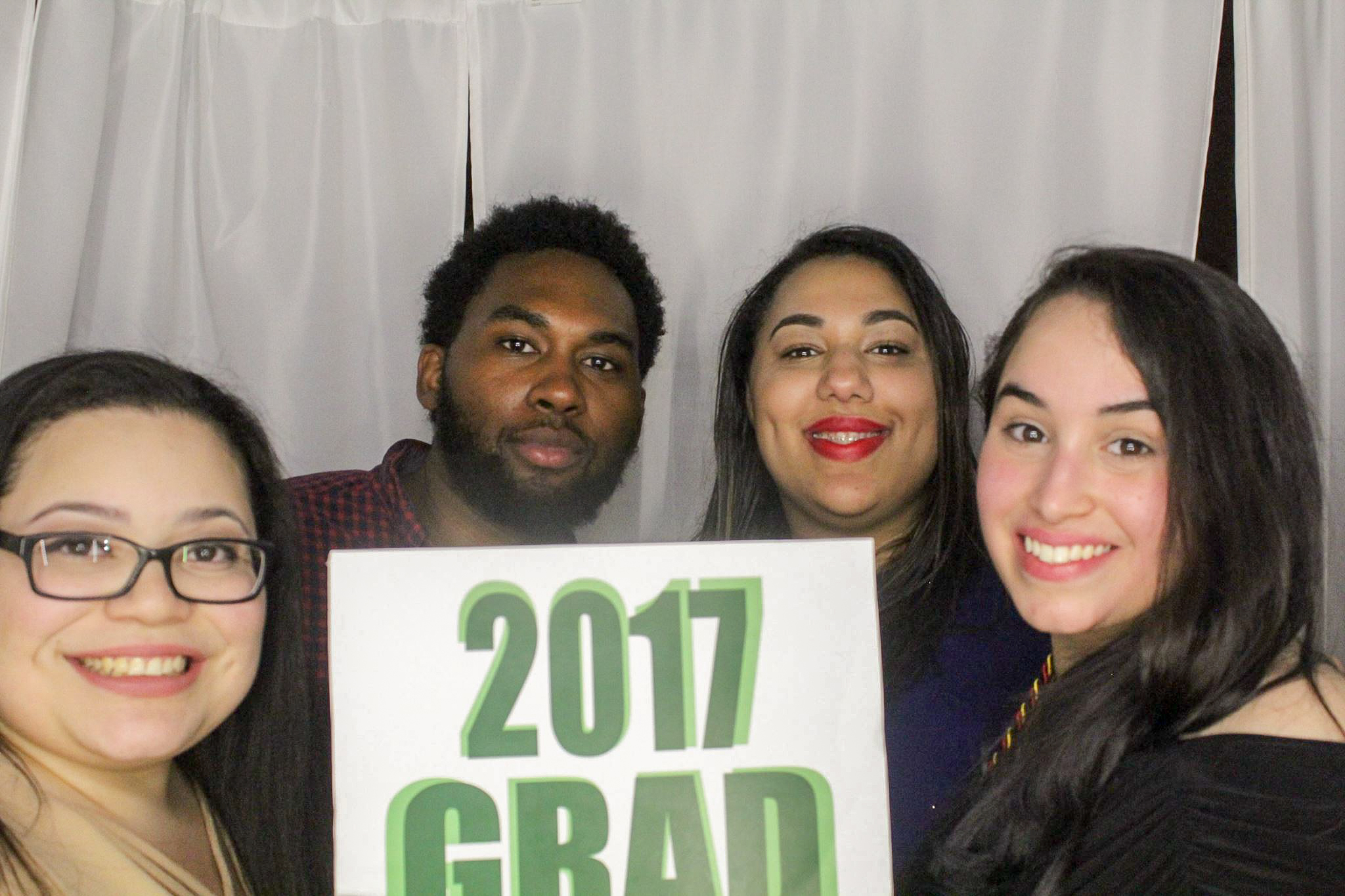 Cynthia Lopez, Mykael Tucker, Glorimi Dejesus and Yaritza Arana Ortega strike a pose in the Unity Gala photo booth.