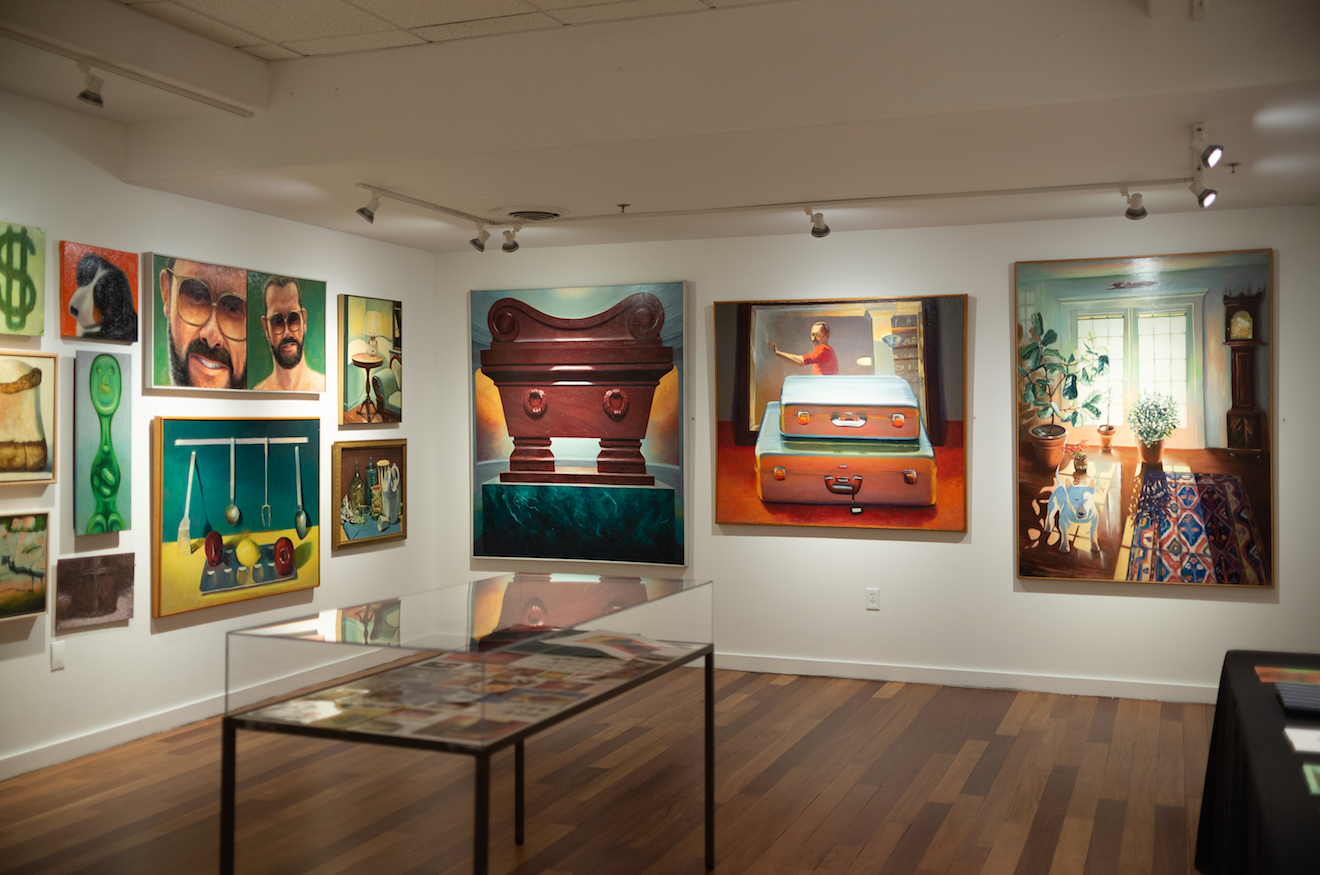 Photograph of paintings on the wall in VanDernoot Gallery