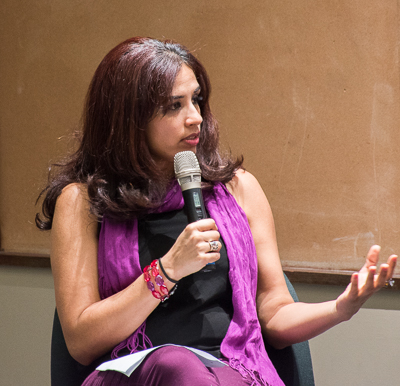 Mariya Taher speaks into a microphone at the panel.