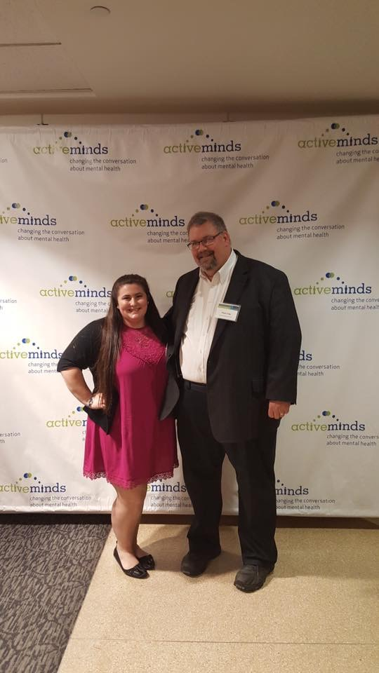 Rachel DiGangi in front of Active Minds sign with Thom Craig at national conference in Washington, D.C.