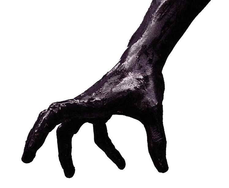 photo of arm reaching down covered in black ink