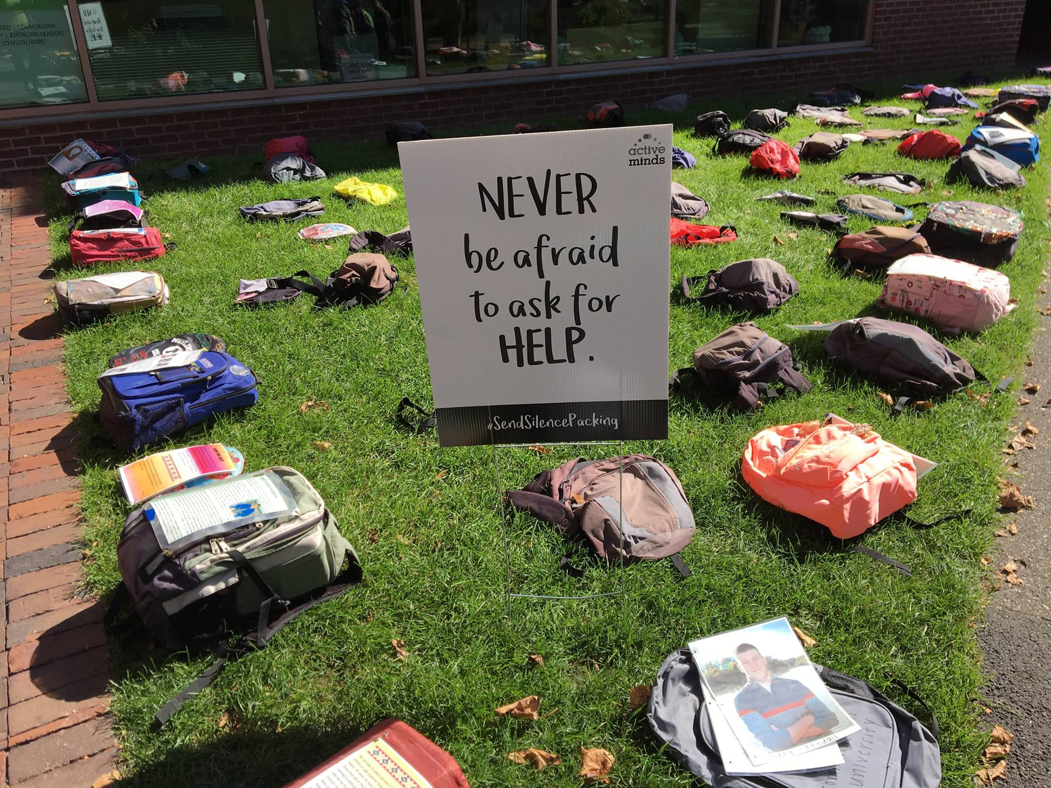 Backpacks on the grass of Doble Quad for Send Silence Packing event.