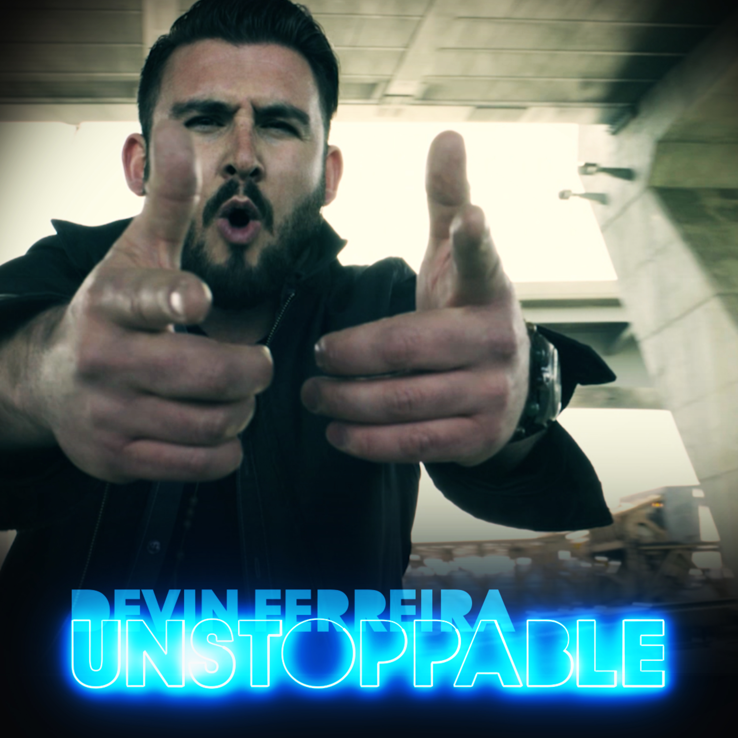 "Devin dferreira's album cover, titled ""Unstoppable"" where he is pointing at camera with both hands, mouth open in a cicular shape."