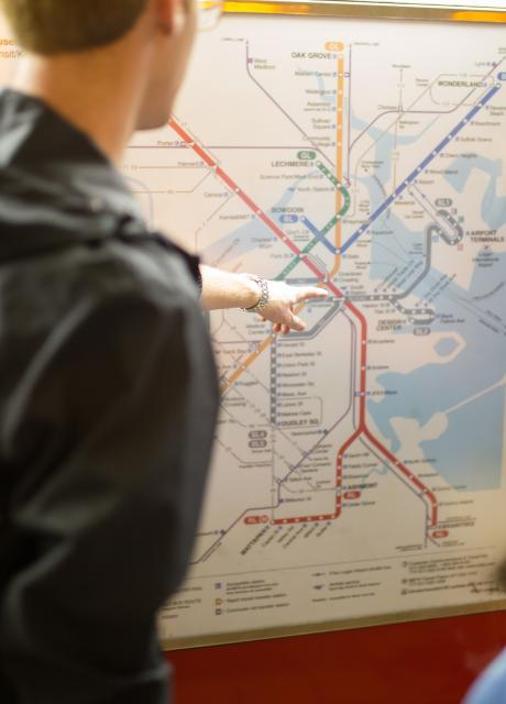 student navigating a subway transportation map