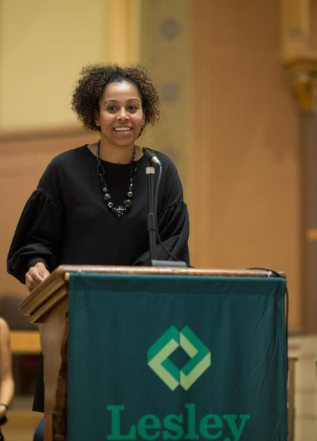 Maritsa Barros speaks at a podium in the church.