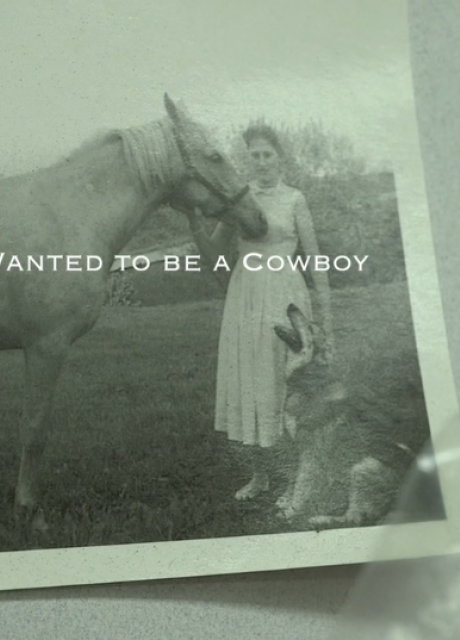 old black and white photo pinned to wall of a woman with horse and dog
