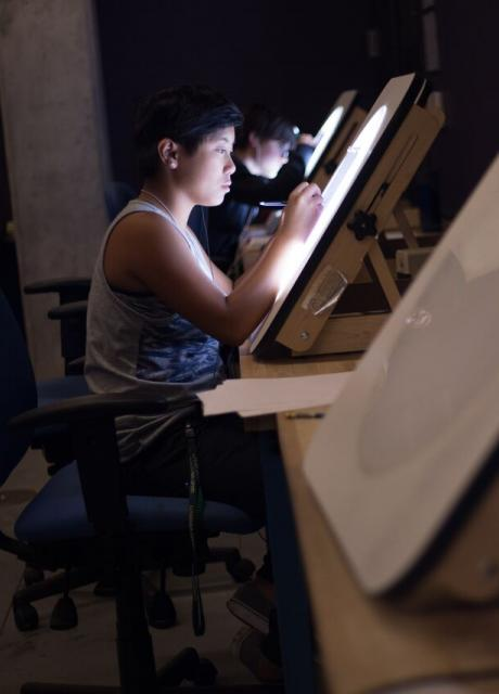 student drawing on lightbox in drawing studio