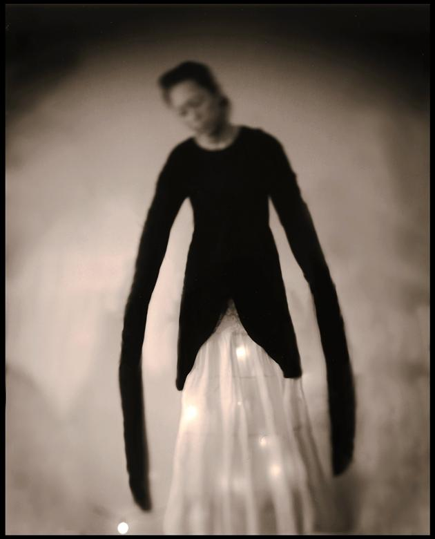 black and white photo of woman with long arms