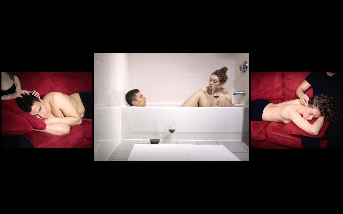 video still of male and female drinking wine in bath tub