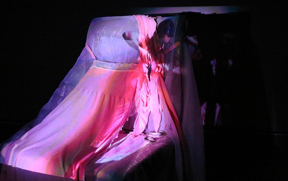 image of video being projected onto pink and purple fabric