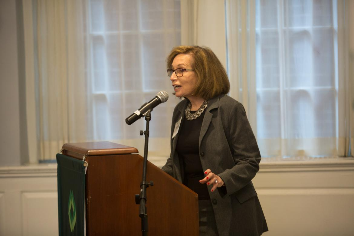 Deborah Schwartz Raizes speaks at a podium in Alumni Hall
