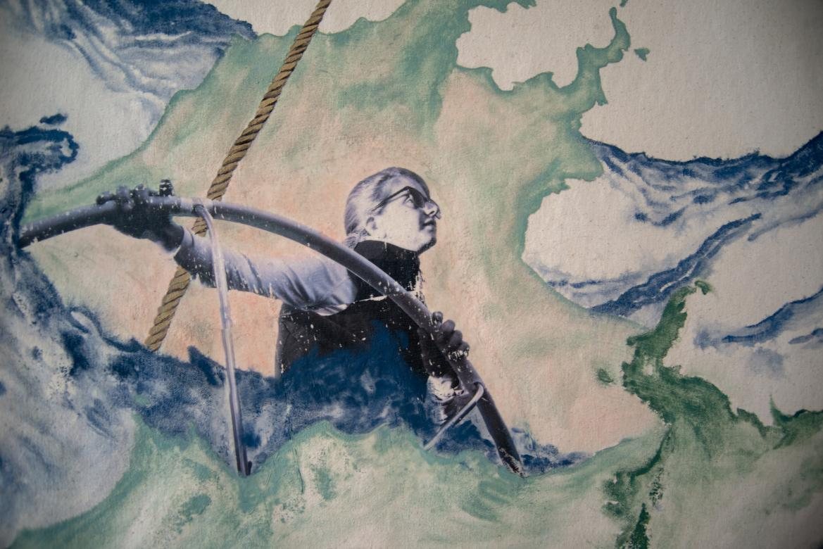 watercolor and pen drawing of a person at the helm of a boat in stormy seas