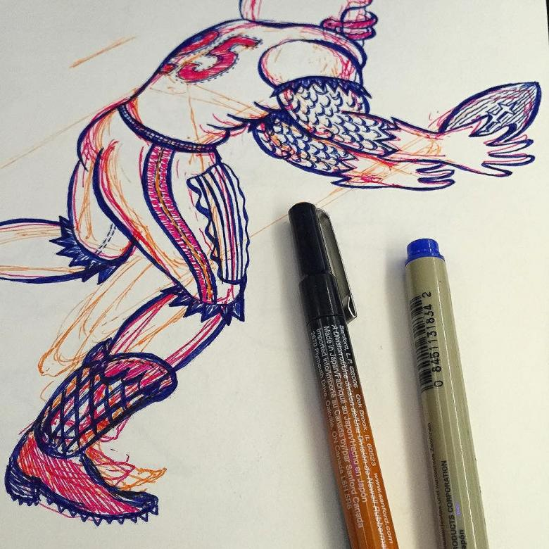 Detail of monster football player catching football with pens in foreground