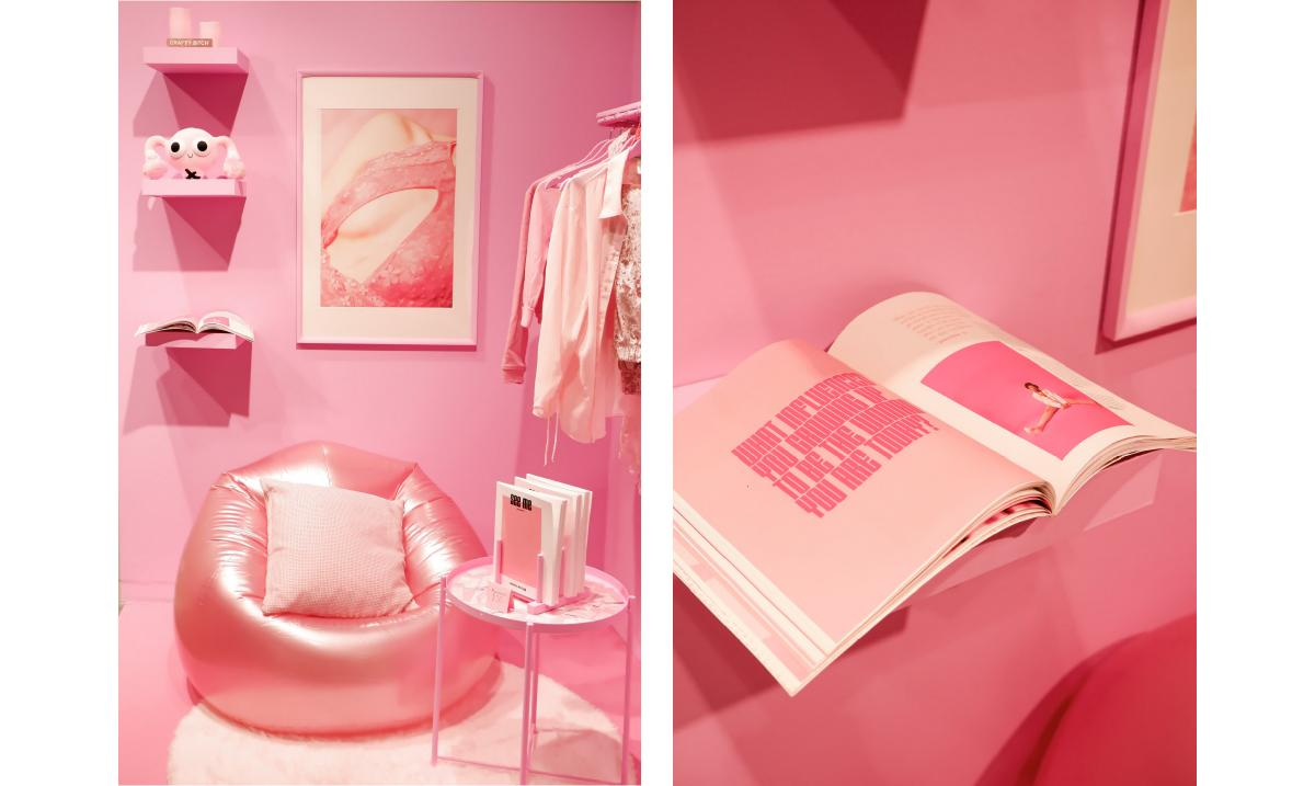 photograph of pink set with chair and shelves, all in pink with painted bright pink wall behind it all