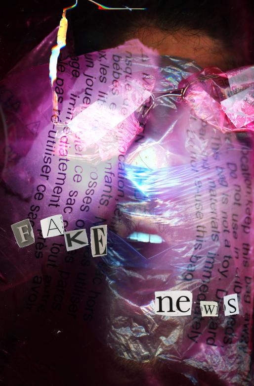 mixed media collage with newspaper clippings and plastic trash tightly wrapped around a screaming face. the words fake news are clipped in the foreground.