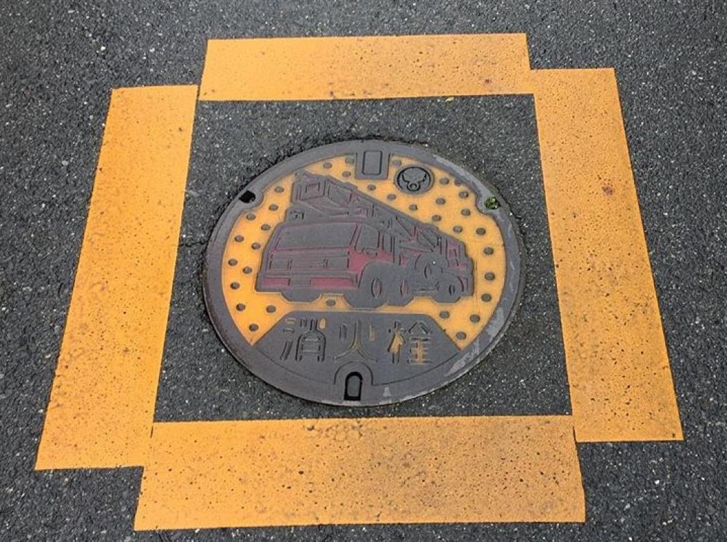 Manhole cover with fire truck