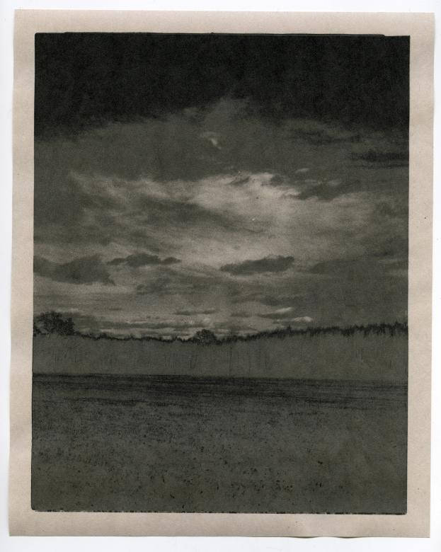 photo negative of ocean seascape on glass plate