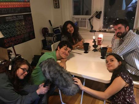 "people sit around a table between takes on the set of the movie ""Know Your Roll"""