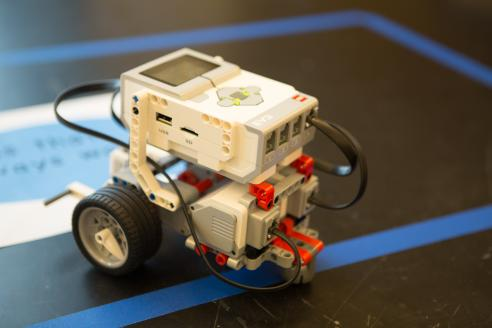 Student built motorized lego with wheels sitting on a table