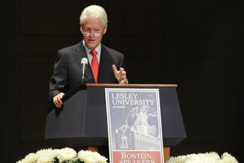 Bill Clinton speaking at a podium