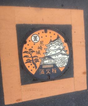 Manhole cover with traditional building.